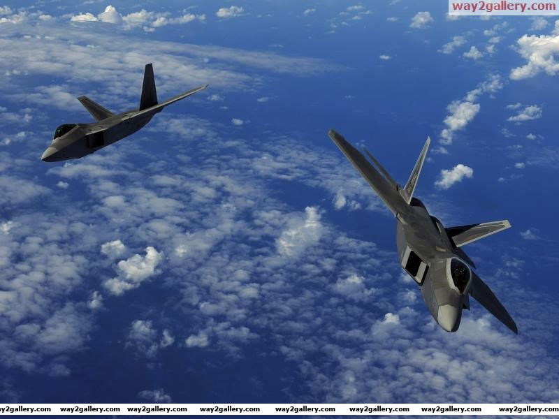 United states air force clouds pacific ocean two f 22a raptor stealth fighter jets near guam