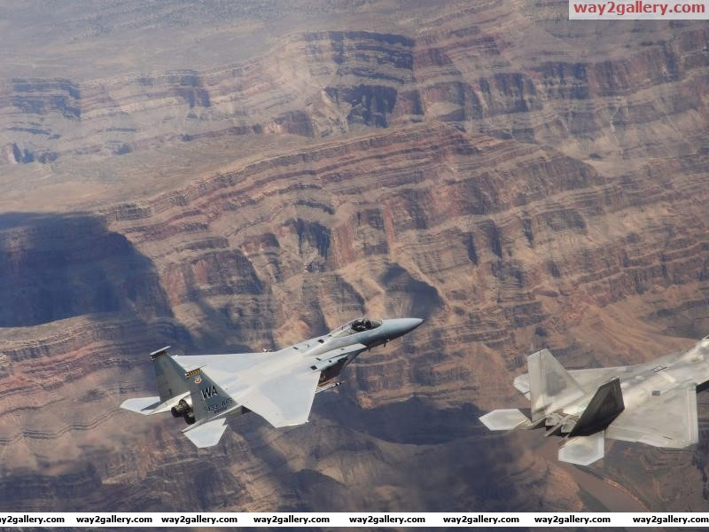 United states air force f 22a raptor f 15c eagle fly over grand canyon arizona