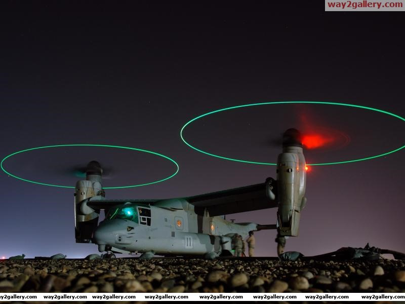 United states navy refueling the mv 22 osprey tiltrotor aircraft at night iraq