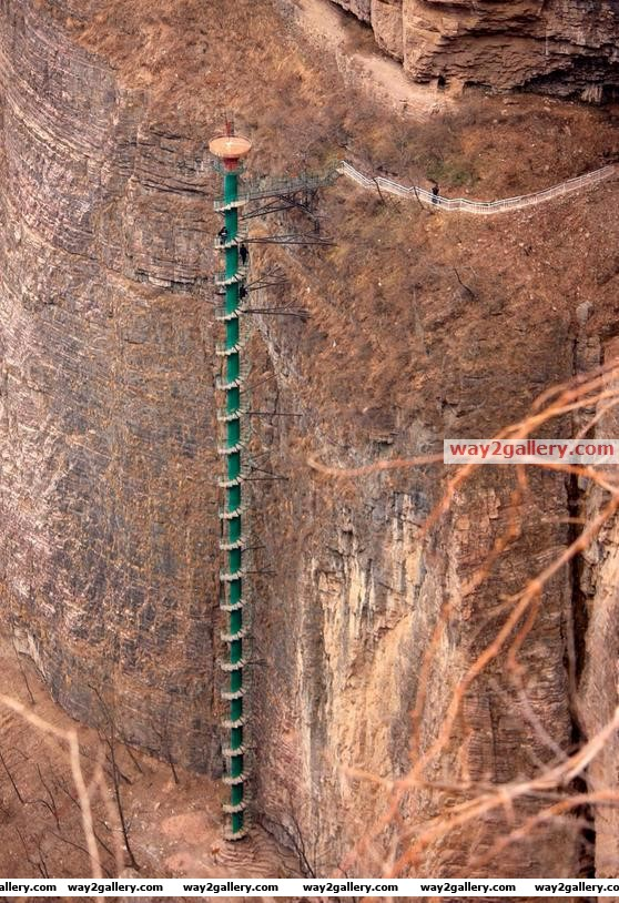 300 ft spiral staircase on the wall of the taihang mountains in linzhou, china.