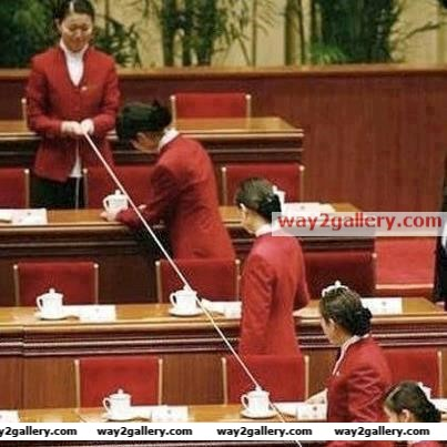 Checking the alignment of the tea cups.its japanese parliament.