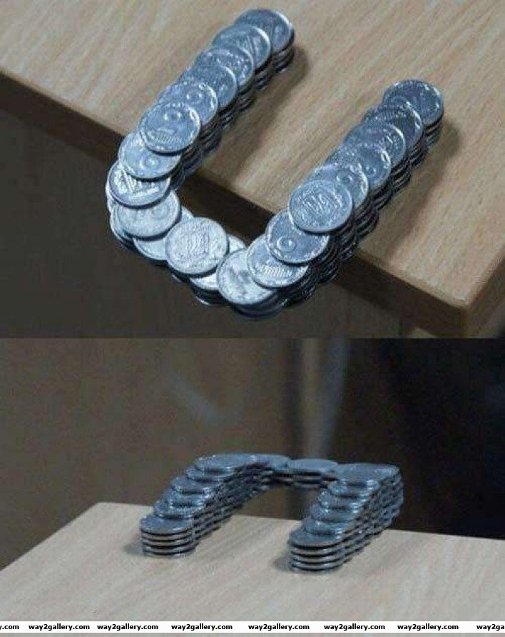 46 coins stacked in such a way that they extend past the edge of the table