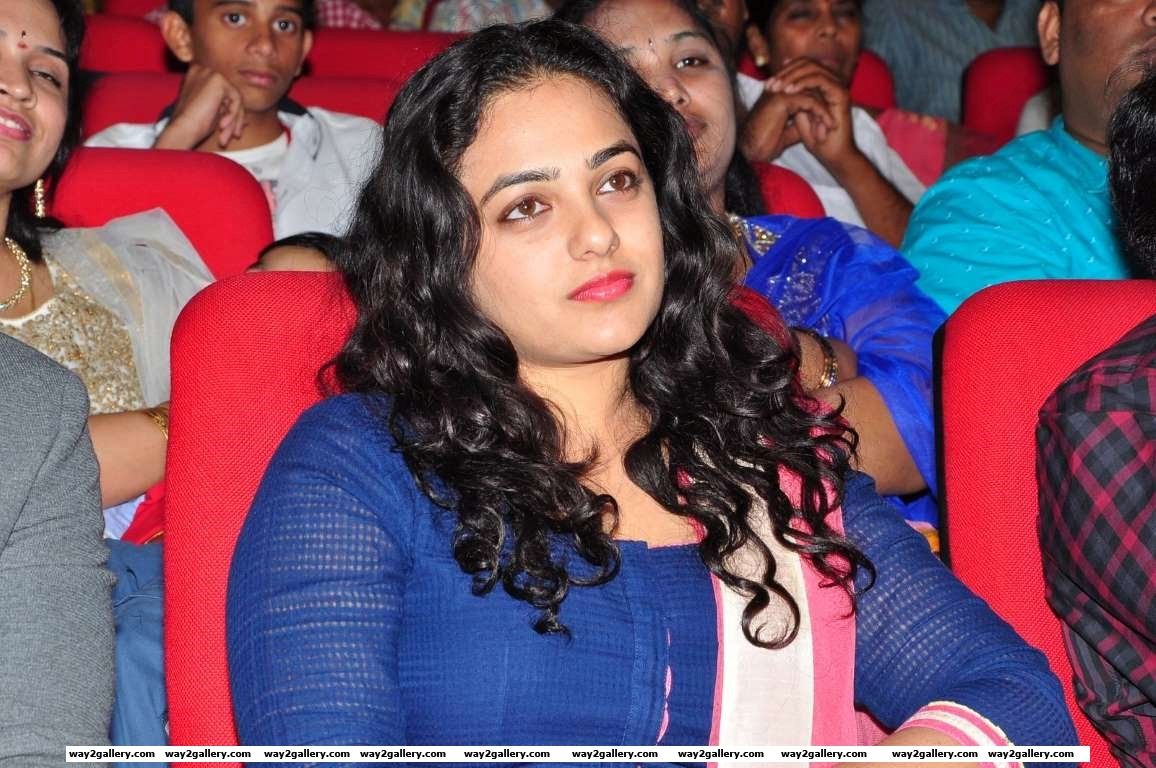 Nithiya Menen takes in the proceedings at the audio launch of her Telugu film Okka Ammayi Thappa