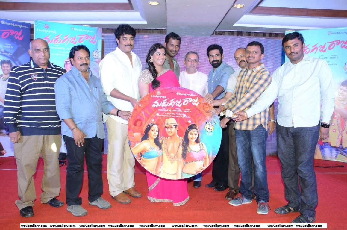 The cast and crew of Tamil film Madha Gaja Raja pose for photographers during the films audio launch