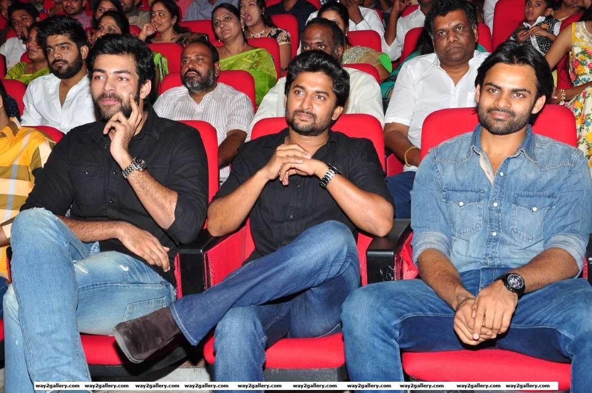 Varun Tej Nani and Sai Dharam Teja take in the proceedings during the audio launch of Telugu film Supreme