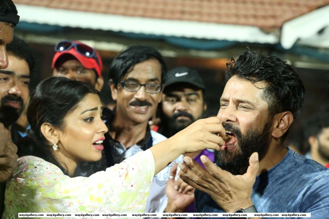 Vikram takes a bite of his birthday cake