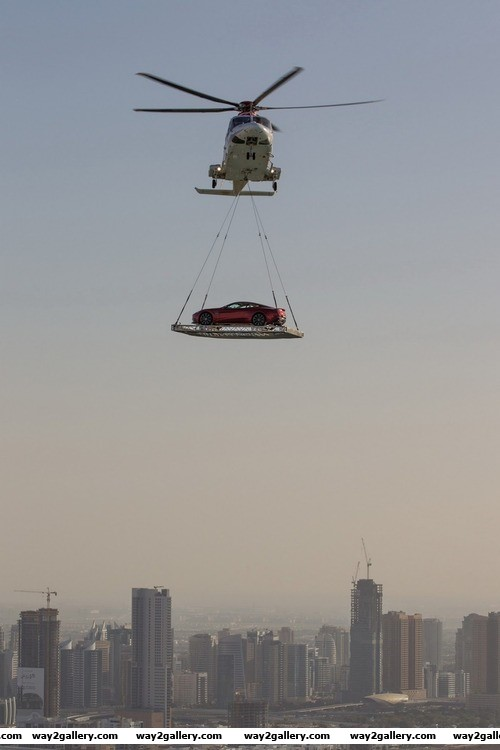 Amazing picture of a car being delivered to a helipad in dubai