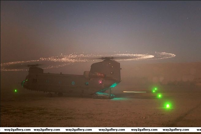 Army helicopter landing in a sandstorm