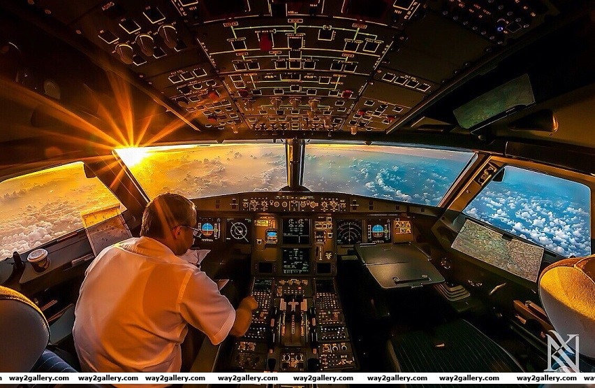 Awesome photo of a pilot lookout out of the cockpit
