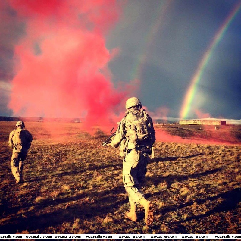 Incredible image of conflict zone with smoke grenades and rainbows