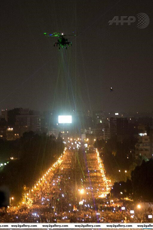 Protesters in egypt shine lasers on military helicopter